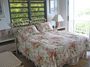 St John rental home Altamira bedroom wtih floral decor and sliding glass door onto balcony with views