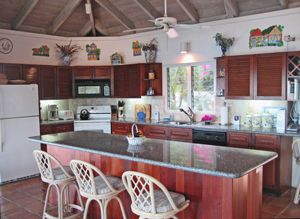 St John rental home Altamira spacious kitchen with tropical decor and large countertop bar space