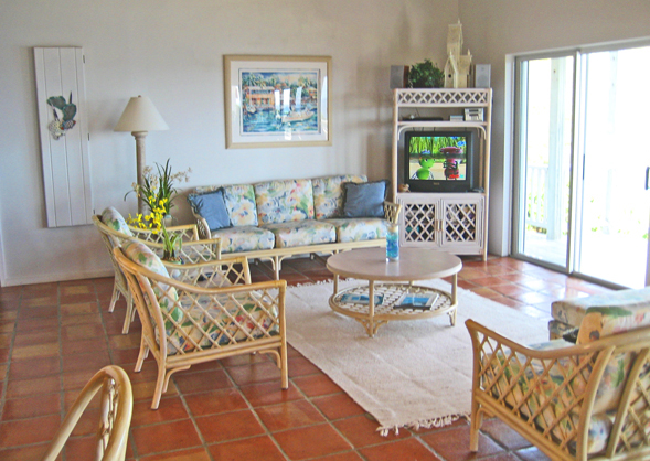 St John rental home Altamira living room with wicher furniture and sliding glass doors