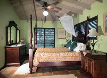 St John vacation rental Meridian large, high ceiling master bedroom with mahogany furniture and king sized bed
