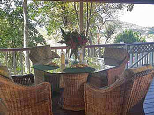 St John vacation rental Meridian outdoor dining on covered deck with expansive views