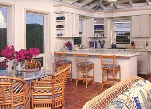 St John USVI vacation rental Viewtiful airy kitchen and dining area with high ceilings opens to the tropically decorated living room