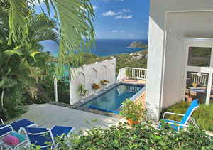 St John Villa Sea Turtle private pool and outdoor seating area on two tiered deck with expansive ocean views