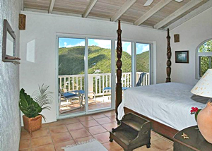 Sea Turtle master bedroom suite 1 with mahogany furniture and views