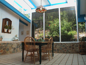 St John USVI vacation rental Tesseract outdoor dining on spacious deck overlooking the pool