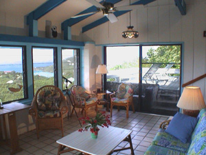 St John USVI vacation rental Tesseract living room with sliding glass doors  that openonto covered deck