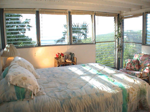 St John vacation rental Tree House has breezy bedroom with king sized bed and wonderful views